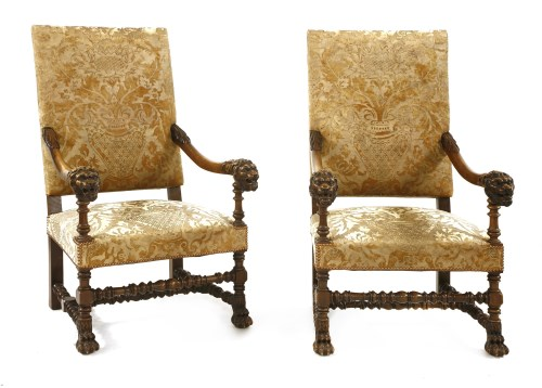 Lot 548-A pair of French walnut open armchairs