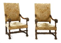 Lot 548 - A pair of French walnut open armchairs