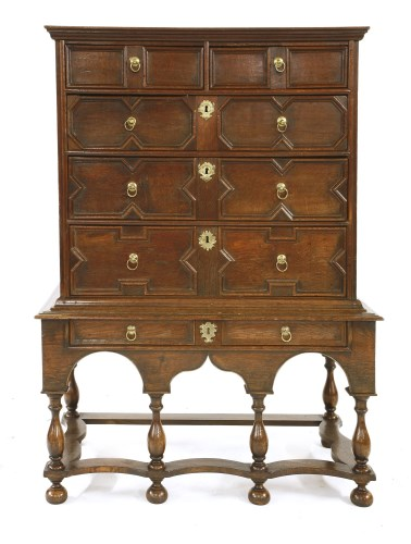 Lot 544-An oak chest on stand