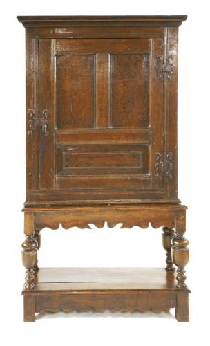 Lot 541-An oak cupboard on stand