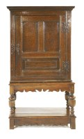 Lot 541-An oak cupboard on stand