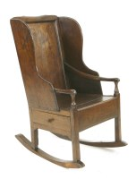 Lot 533 - An oak rocking chair