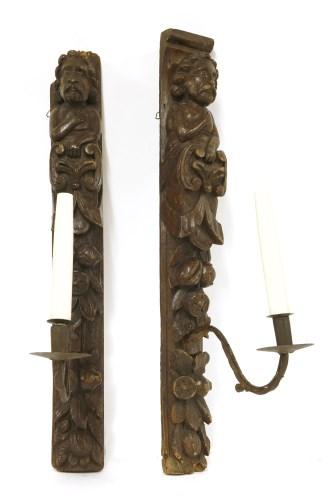 Lot 545-A pair of oak wall brackets
