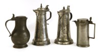 Lot 546 - Two pewter lidded jugs