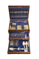 Lot 65-An early 20th century Walker and Hall oak cased canteen of cutlery