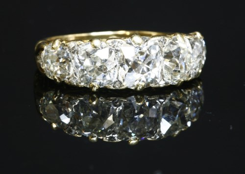 39 - A Victorian five stone carved head diamond ring