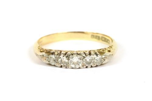 Lot 22-A graduated five stone diamond ring