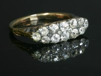 Lot 60-An Edwardian two row diamond boat shaped carved head ring