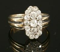 Lot 56-An Edwardian diamond cluster ring
