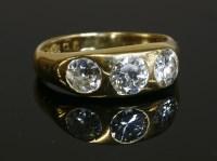 Lot 601-A gentlemen's 18ct gold three stone diamond ring