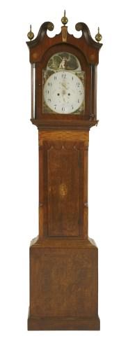Lot 534-An eight-day oak and mahogany longcase clock