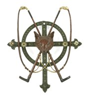 Lot 19-A cast iron wall hanging whip stand