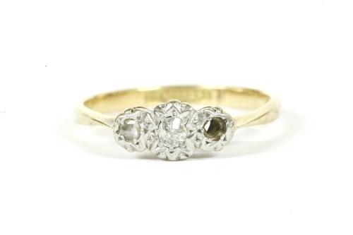 Lot 18-A gold three stone illusion set diamond ring