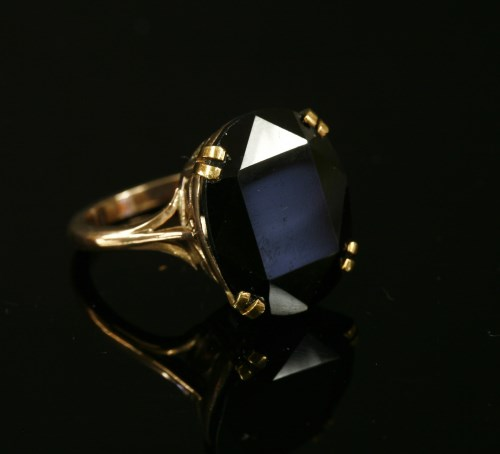 Lot 9-A gold single stone oval cut andalusite ring