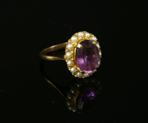 Lot 7-A 9ct gold oval mixed cut amethyst and seed pearl cluster ring