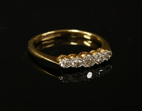 Lot 6-A gold five stone diamond ring