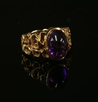Lot 14-A gold single stone amethyst cabochon ring