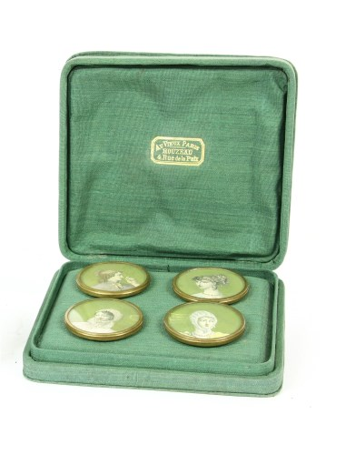 Lot 16-Four cased painted miniature buttons of young maidens