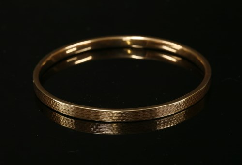 Lot 20-A 9ct gold hollow flat section slave bangle