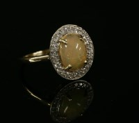 Lot 19-A gold opal cabochon and diamond cluster ring