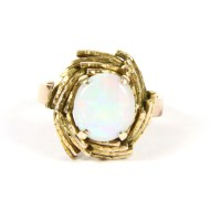 Lot 8-A gold single stone cabochon opal ring