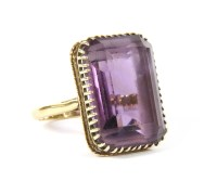 Lot 5-A gold single stone emerald cut amethyst ring