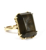 Lot 11-A 9ct gold single stone smokey quartz ring