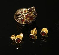 Lot 19-A five row garnet set ring joined as one