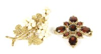 Lot 13-A 9ct gold oval cut garnet cluster brooch