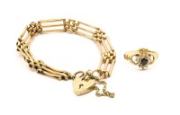 Lot 2A-A gold three row gate link bracelet with padlock