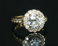 Lot 38-A gold diamond set Daisy cluster ring