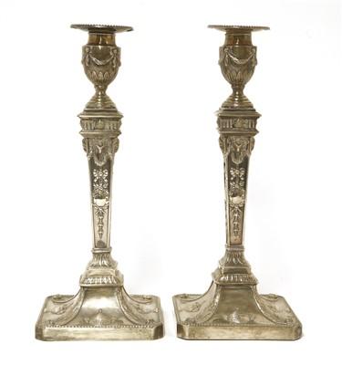 Lot 35-A pair of George lll Adam design silver candlesticks