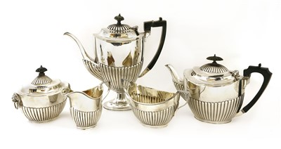 Lot 28-An Elkington & Co. silver three-piece tea service