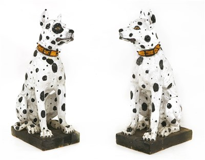 Lot 549-A pair of life-sized Continental majolica pottery models of seated Great Danes