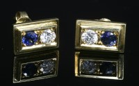 Lot 12A-A pair of gold two stone sapphire and diamond stud earrings