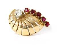 Lot 4-A single gold diamond and ruby cornet shaped earring