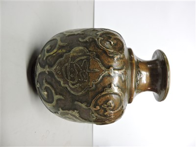 Lot 6-An Islamic copper vase