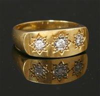 Lot 602-A gentlemen's 18ct gold three stone diamond ring