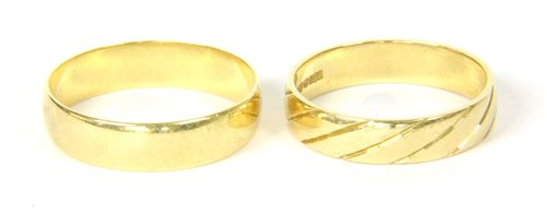 Lot 10-Two 18ct gold wedding rings