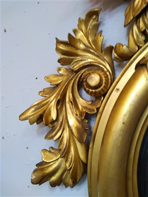 Lot 25-A Regency giltwood convex wall mirror