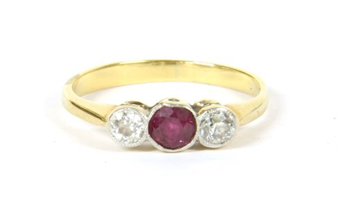 Lot 13-Ruby and diamond 3 stone ring
