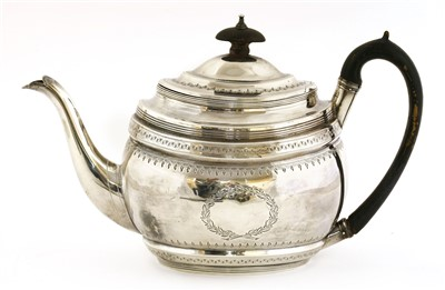 Lot 4-A George III silver teapot