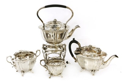 Lot 21-A four-piece silver tea set