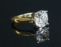 Lot 43-An 18ct gold single stone diamond ring