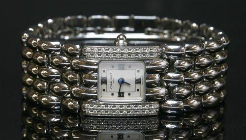 Lot 539 - A ladies' stainless steel diamond set Chaumet Khesis quartz bracelet watch