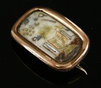 Lot 2-A Georgian gold cased masonic brooch of elongated cushion form