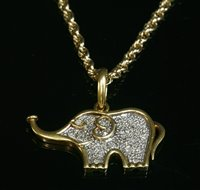 Lot 20-A two colour gold diamond set elephant pendant