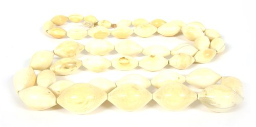 Lot 7-A single row 19th century graduated navette shaped ivory bead necklace