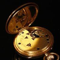 Lot 590-An 18ct gold open faced pocket watch