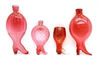 Lot 314 - A cranberry glass boot form gimmel flask